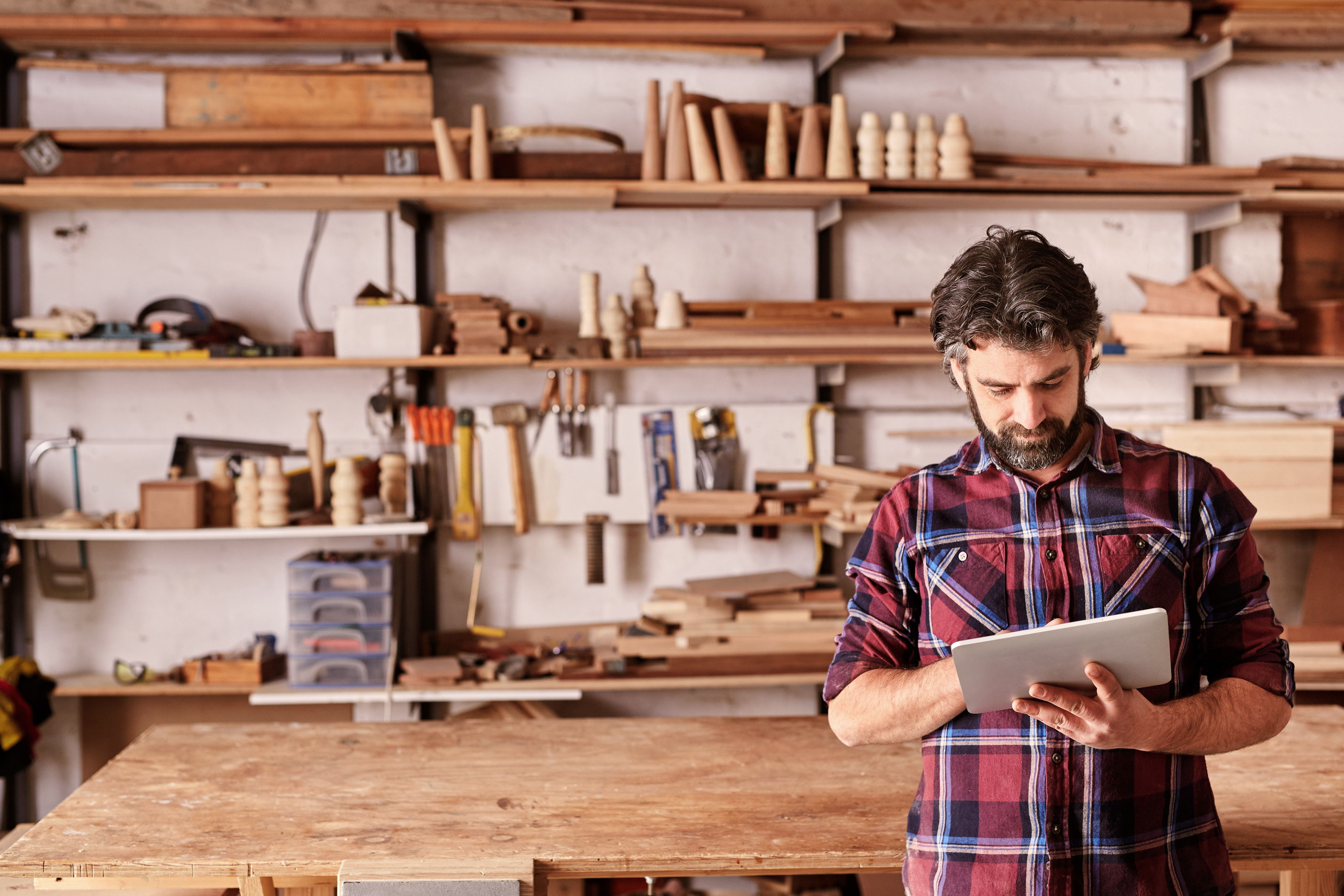 A Small Business Owner In A Wood Shop